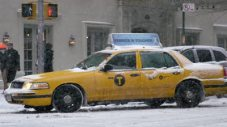 stock-footage-new-york-january-taxicab-turning-corner-snowing-in-k-slow-motion-shot-on-red-epic